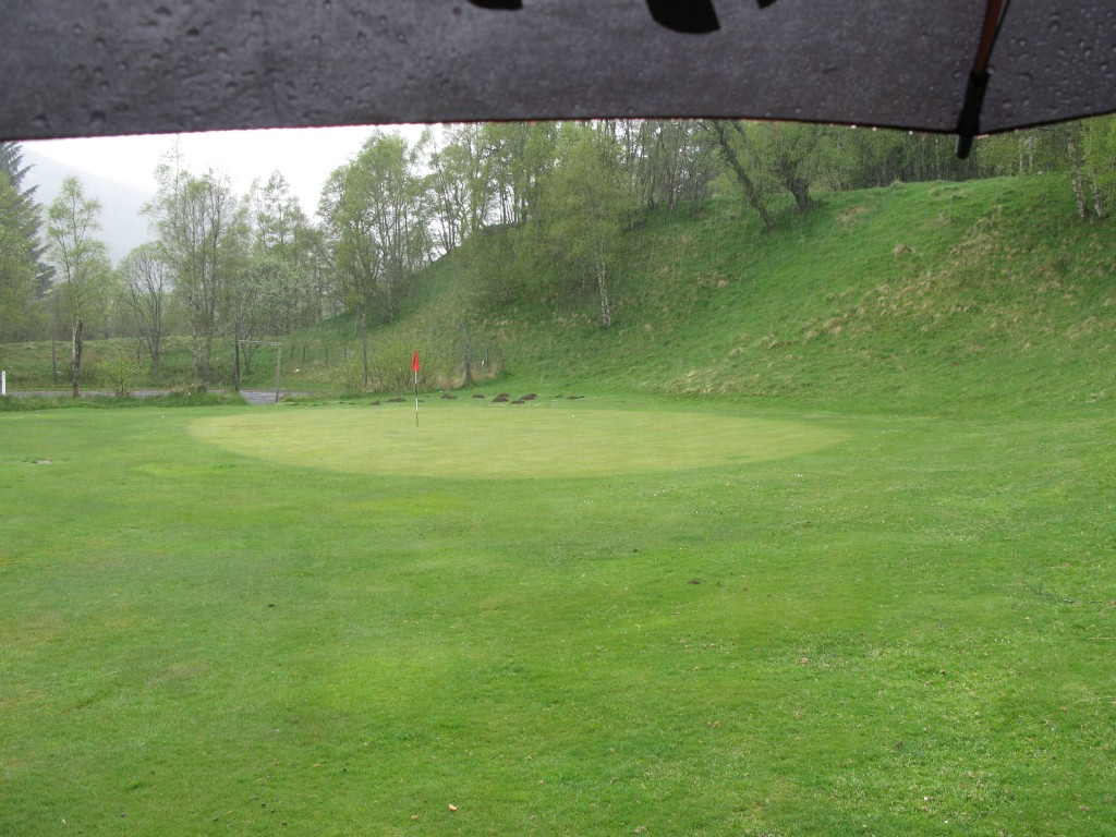 9th green at Dalmuzie with dilapidated tennis courts in the background - an apt finishing hole at Dalmunzie